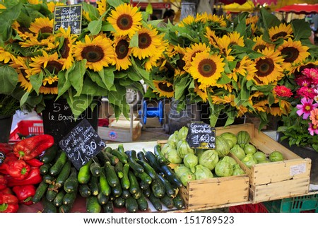 Sunflowers and vegetables for sale at a market in Aix-en-Provence - stock photo
