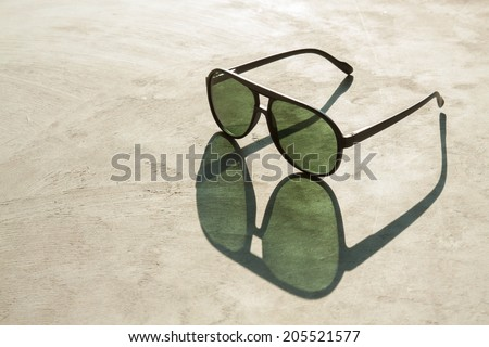 Sunglasses and Shadow - stock photo