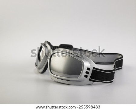 Sunglasses for skiing, fly a plane or riding a bike on white background - stock photo