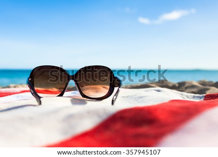 Sunglasses on the beach.  - stock photo