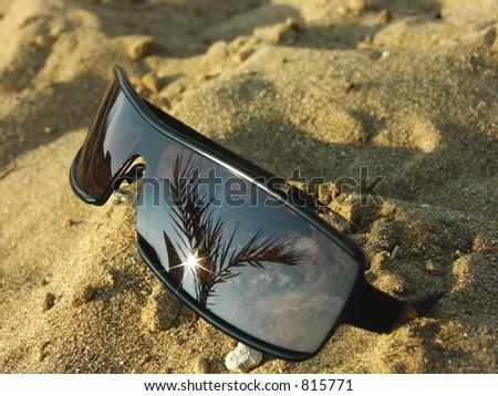 sunglasses on the sand - stock photo