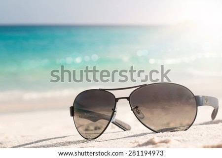 Sunglasses on the tropical beach. Travel relax vacation - azure sea, white sand, shining sun, Summer paradise day on exotic bay Grand Anse, La Digue Island, Seychelles, Indian Ocean - stock photo