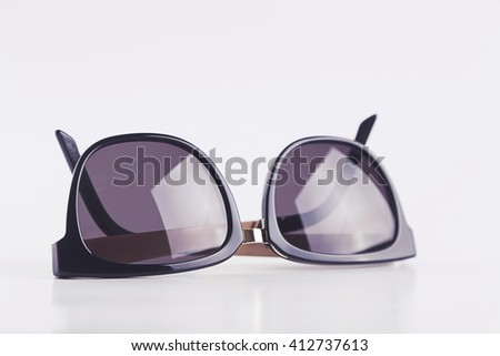 Sunglasses on white background - stock photo