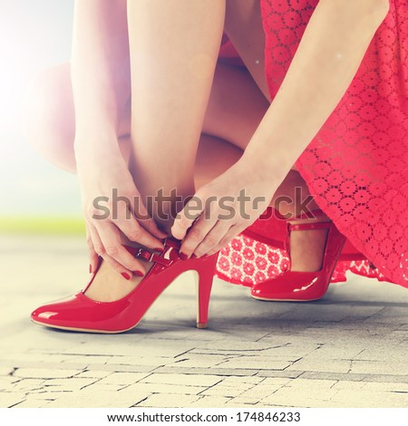 sunlight and red shoes  - stock photo