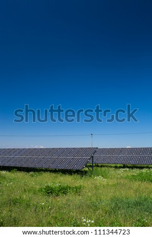 Sunlight as a resource of renewable energy: solar panels on a sunny day - stock photo