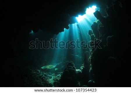 Sunlight in an underwater cave - stock photo