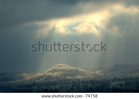 Sunlight Rays on Icy Hill - stock photo