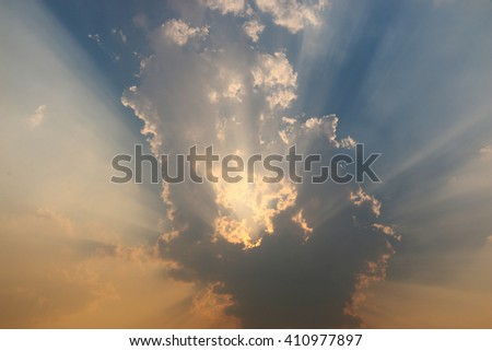Sunlight shining through the clouds for background - stock photo