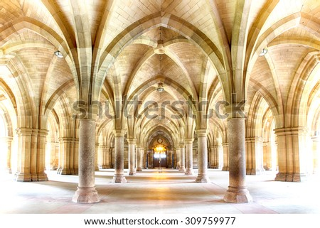 Sunlight streams into the historic Cloisters of Glasgow University. Subtle HDR processing. - stock photo