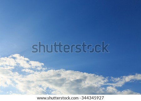 sunlight through cloud on clear blue sky background - stock photo