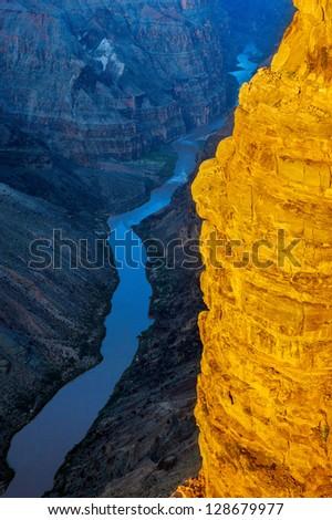 Sunlit cliff at Toroweap above Colorado River, Grand Canyon, Arizona - stock photo