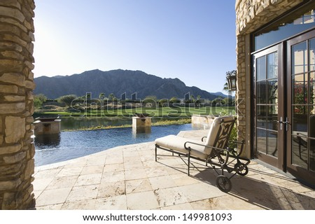 Sunlounger with view of mountains in Riverside County; California - stock photo