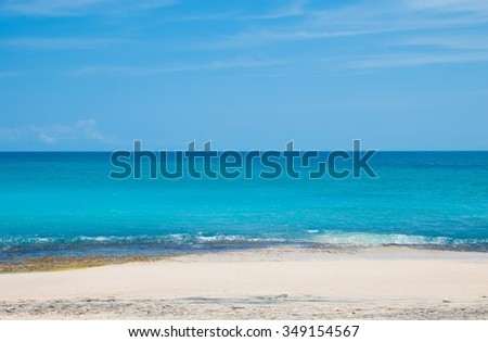 Sunny and warm beach on the island of Bali. The beach called Dreamland and is located on the Bukit Peninsula. Indonesia - stock photo