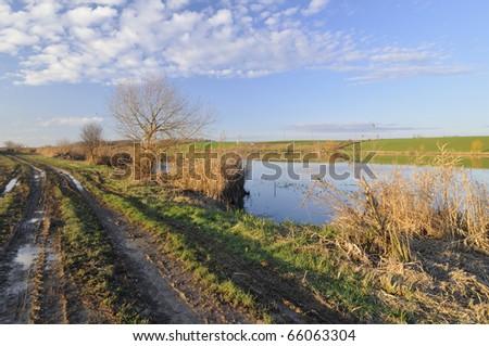 Sunny autumn day on the lake - stock photo