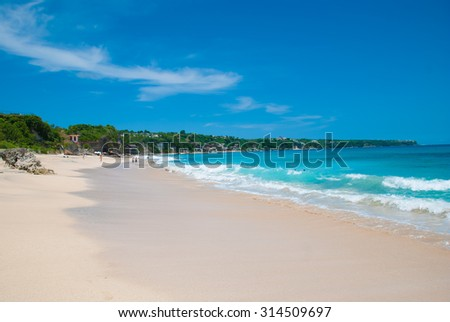 Sunny beach called Dreamland in Bali, Indonesia. - stock photo