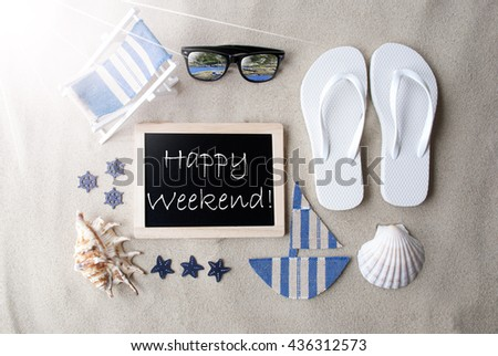 Sunny Blackboard On Sand With Text Happy Weekend - stock photo