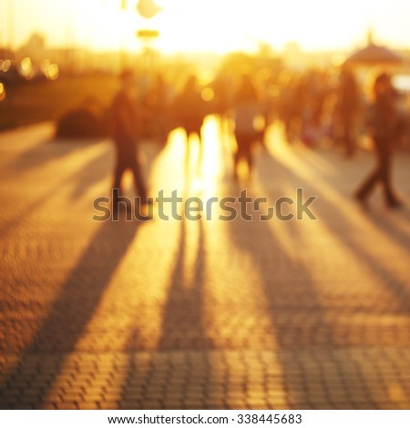 sunny blur summer bright photo of people on street outdoor. Evening yellow sunlight - stock photo