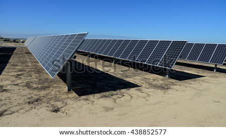 Sunny Central California is the scene of acres of solar panel arrays generating megawatts of clean electrical power. - stock photo