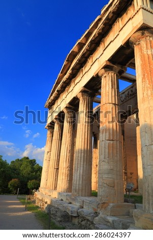 Sunny columns of a Greek temple in Ancient Agora, Athens, Greece - stock photo