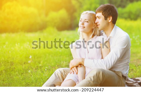 Sunny couple in love enjoying nature in warm sunny day - stock photo