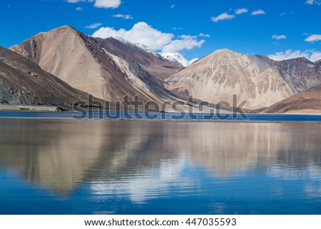 Sunny day at Pangong Lake and Himalayan mountain. Pangong Lake, is an endorheic lake in the Himalayas situated at a height of about 4,350 m in Ladakh, India - stock photo