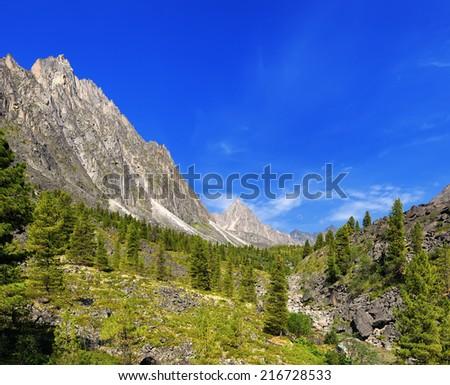 Sunny day in a Siberian mountain valley. Barun-Handagay. Sayan mountains. Buryatia - stock photo