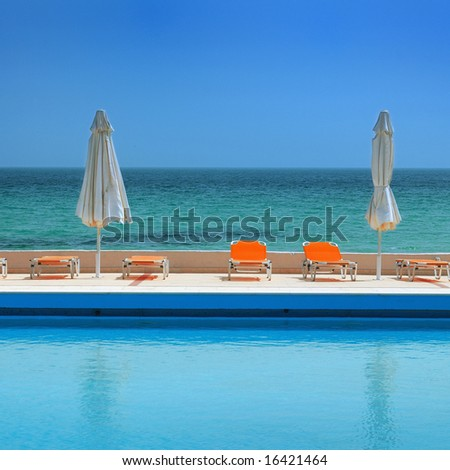 sunny day on a swimming pool, beach view - stock photo