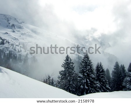 Sunny day on ski with fog and shadow - stock photo