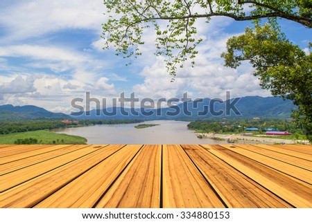 sunny day with landscape and terrace - stock photo