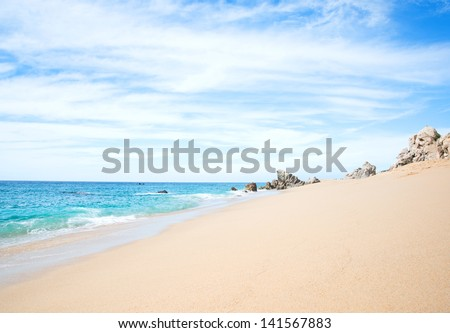 Sunny Empty Beach in Cabo San Lucas, Mexico - stock photo