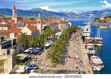 Sunny harbor of an old Venetian town with Romanesque architecture, Trogir, Croatia - stock photo