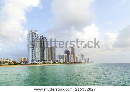 SUNNY ISLES BEACH, USA - AUG 17, 2014: people catch fishes at  the pier in Sunny Isles Beach, USA. In 1936, Milwaukee malt magnate Kurtis built the Sunny Isles pier. - stock photo