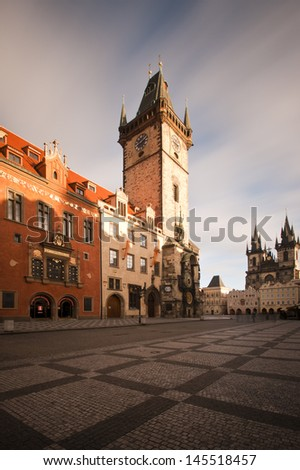 Sunny morning view on the astronomical clock and Tyn church on the Old Town Square in Prague - stock photo