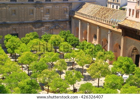 Sunny patio of the Cathedral of Saint Mary of the See (Seville Cathedral) in Seville, Andalusia, Spain - stock photo
