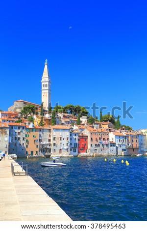 Sunny pier near the Adriatic sea and the old Venetian town of Rovinj, Croatia - stock photo