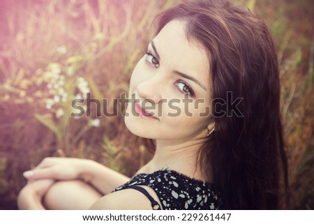 sunny portrait of a girl in the park - stock photo