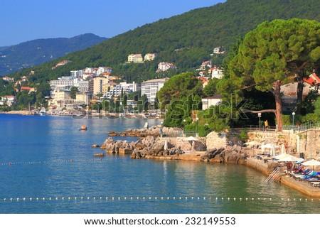 Sunny promenade and small beaches near the sea, Opatija, Croatia - stock photo