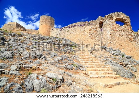 Sunny ruins of Venetian fortress built on a hill near Argos, Greece - stock photo