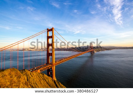 Sunny San Francisco skyline with the Golden Gate Bridge - stock photo
