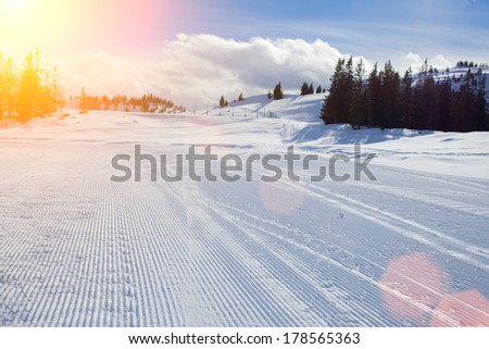 Sunny slope on the skiing resort. Austria. - stock photo