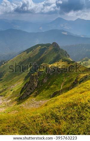 Sunny summer scene in the mountains. View of beautiful landscape of a green hills. - stock photo