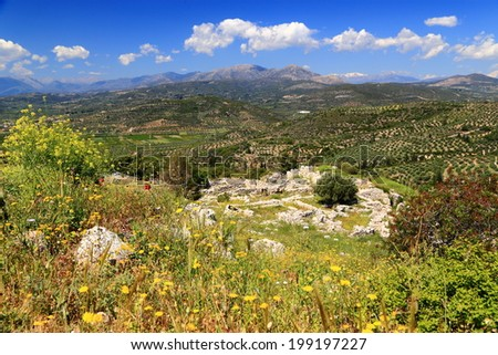 Sunny valley and hills surrounding the ruins of Mycenae, one of the major centers of Greek civilization, Peloponnese, Greece - stock photo