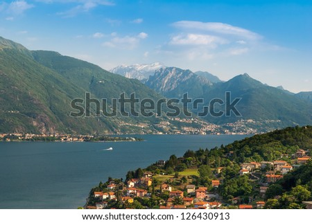 Sunny view on lake Como - stock photo
