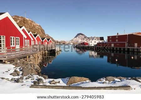 Sunny winter day in small harbour of village Mortsund, Lofoten islands, Norway - stock photo