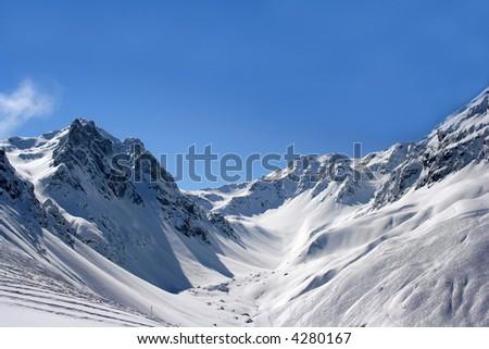 Sunny winter mountains - stock photo