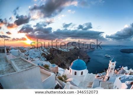 Sunrise against church on Santorini island in Greece - stock photo