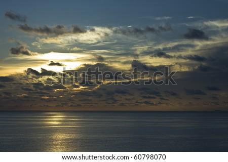 Sunrise along the coast - stock photo