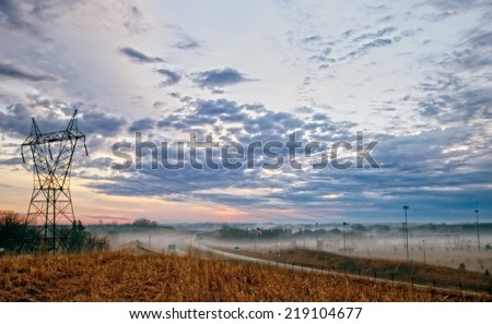 Sunrise amongst urban sprawl - stock photo