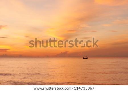 Sunrise and fisherman. - stock photo