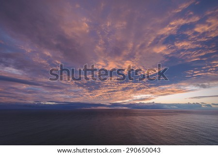 Sunrise as seen from the top of a cliff side hike on Oahu, Hawaii's most eastern point.  - stock photo